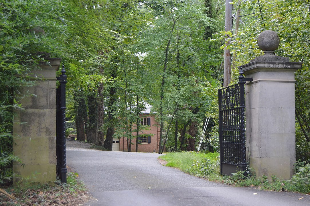 Gated entrance to bridge over creek to Lock Island and the Rice House